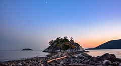 Atmospheric oceanfront (Christie : Colour & Light Collection) Tags: whytecliff park vancouver westvancouver bc canada atmospheric oceanside ocean island rock rockformation howesound britishcolumbia bluehour evening sunset sundown rocks bolders trees crescentmoon moon thenorthshore coastline coast line riggedcoastline logs beach scenic oceanfront whyteislet