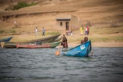 Local fishermen, Mweya, Uganda, 2017 (Catherine Gidzinska and Simon Gidzinski/grainconno) Tags: 2017 africa africans eastafrica june uganda boat launch launching man men paddle sunset walking water mweya westernregion ug flickrtravelaward