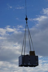New Air Conditioner (Let Ideas Compete) Tags: crane suspended lifting sky clouds