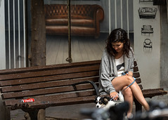 Reality Check. V2 (Flavio~) Tags: streetphotography bench sofa chair woman young dog coke brown juxtaposition contrast wall sexy legs telaviv street reality expectation rehovotphotographyclub florentin hadass bor