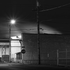 Not Right Away (rosenunezsmith) Tags: plywood night eugene builtlandscape lumber kilns roadsigns steam longexposure oregon road lowlight america industrial lanecounty telephonelines pacificnorthwest telephonepoles lumbermill fence pnw upperleftusa fences highway street