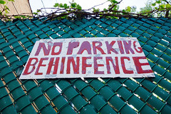 Please park your BEHINFENCE elsewhere (KevinIrvineChi) Tags: sign signs handpainted handmade hand painted chainlinkfence chainlink chicago chicagoist red white green slats grid pattern illinois lincolnsquare alley back sony dscrx100 warning selfbehinfence behinfence no parking noparking nope not here dont do it worth penalty funny missing letter spacing ivy touch up touchups touched