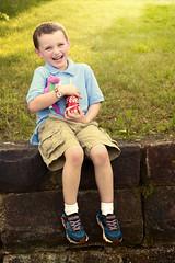 Coke and a Smile (DaveLawler) Tags: coke cocacola mickey mouse watch stuffed dinosaur brick wall smile child boy charlie nikon nikkor