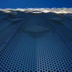 Tvibit (twoeye) Tags: tvibit tromsø architecture perforated aluminium blu hole angled fold folded loxia sony hrtb loxia2821