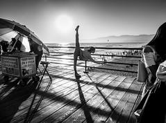 Stretch! (tritranla) Tags: california olympus urban artistic people losangeles streetphotography mirrorless candid city