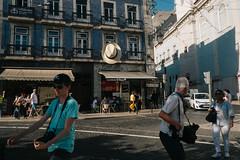 Lisbon, Portugal (f.d. walker) Tags: europe lisbon portugal hat hats wind people person streetphotography street sunlight shadow sun surreal candidphotography candid color colorphotography contrast city