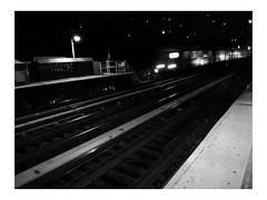 sound of loneliness (vfrgk) Tags: trainstation train passing loneliness lonely lamp lamppost nightphotography nightshots nightview melancholic perspective rails monochrome bw blackandwhite emptiness blur mta nyc urbanfragment urbanbeauty urbanlandscape urbanlife urbanphotography streetscene streetphotography streetfragment transportation citylife lines