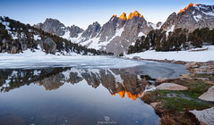 Pinnacles Burn (Mohanram Sathyanarayanan) Tags: snow mountain landscape water scenic noperson outdoors travel nature ice lake daylight sky winter cold rock reflection sierra ranges wilderness alpenglow morning sunrise lakes sequioa kingscanyon nationalpark camping colors panorama
