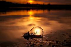 Bulb (petrisalonen) Tags: bulb electricbulb sunset sunrise landscape water yellow bokeh finland orange light