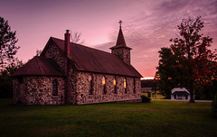 The Stone Church (T P Mann Photography) Tags: dslr eos 6d canon m32 historic catholic windows glow sundown sunset sun light dusk evening michigan pure puremichigan breezeway country rural building stone steeple church jordan east
