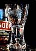 Macro Mondays - Poisonous (Leslie Victor) Tags: 37212 macromondays poison vodka smirnoff blackbackground macro shotglass droplets hmm