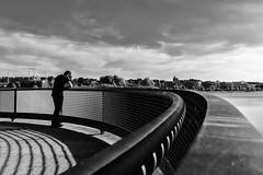 Lonely Man (tan.ja1212) Tags: see lake monochrom schwarzweis mann man licht light schatten shadow himmel sky wolken clouds geländer railing