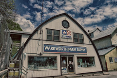 Farm Supply (gabi-h) Tags: warkworth farmsupply store farmers gabih architecture buildings rural northumberlandcounty windows propanetanks siding purina fence chainlink bluesky clouds spring windowswednesday