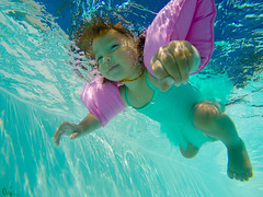 Granddaughter's First Underwater Adventure (Kevin MG) Tags: girl granddaughter water underwater floaties toddler bathingsuit smiles summer swimming pool child kid young youth cute little submerged