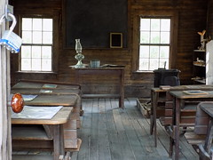 School House Interior. (dccradio) Tags: whiteoak nc northcarolina bladencounty collydistschool schoolhouse oneroomschoolhouse desk inside interior window woodfloor woodenfloor wood floor studentdesk masterlock teachersdesk lantern lamp oillamp oillantern doorknob tablet chalkboard stove shelf historical historicalsite history livinghistory harmonyhallplantation harmonyhall plantation nikon coolpix l340