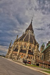 Ottawa Ontario Canada ~ Parliament Hill and  Library ~ Historical Site (Onasill ~ Bill Badzo) Tags: 18250mm ottawa on ontario historic site federal government buildings architecture style gothic victorian library gardens heritage tours attraction travel parliament hill onasill canon rebel eos sl1 d1000 camera hdr sigma macro clouds sky sunset nrhp register building canadacapitol tower outdoor skyline capitol city lower town storm