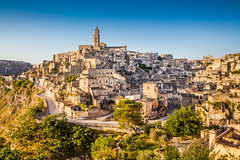 Matera (Voyages Lambert) Tags: matera tourism stoneobject morning buildingexterior landscaped goldcolored dusk belltowertower scenics medieval history thepast journey blue ancient old italianculture cultures famousplace architecture traveldestinations vacations urbanscene basilicataregion italy europe sunset sunrisedawn lightnaturalphenomenon summer rockobject cave hill canyon ravine sky house cathedral church monument tower builtstructure urbanskyline cityscape city village town sassidimatera unescoworldheritagesite