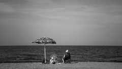 low season (lorenzog.) Tags: lowseason marinadiravenna beach beachlife umbrella beachumbrella adriaticsea mareadriatico rivieraromagnola romagna emiliaromagna italy canon ilobsterit summer holiday vacation people heatwave