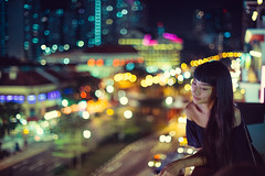 Singapore Evening (Jon Siegel) Tags: nikon nikkor d810 50mm 12 nikon50mmf12ais woman girl beautiful gorgeous night skyline evening chinese chinatown singapore singaporean people city urban bladerunner bokeh beauty