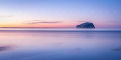 Bass Rock Blues (Scott Masterton) Tags: bassrock eastlothian scotland scottmasterton sunset tranquility beach blue color fascinatinglight firthofforth gloaming holiday idyllic longexposure nopeople northberwick peaceful pentax reflection sea seacliff sky travel uk vacation camera:make=ricohimagingcompanyltd exif:make=ricohimagingcompanyltd exif:lens=sigma1770mmf284dcmacrooshsmc013 exif:focallength=28mm exif:isospeed=100 geostate camera:model=pentaxks2 exif:model=pentaxks2 geolocation geocountry geocity exif:aperture=ƒ80