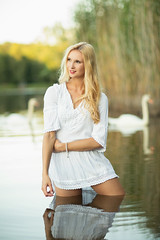 lake in the summer (Michael Kremsler) Tags: model shooting girl blond dress natural lake water summer swan reed evening availablelight bokeh portrait fashion outdoor