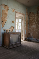 The glow calls from outside once more (No Stone Unturned Photography) Tags: abandoned house home living room tv television wood floor urbex peeling wallpaper blue rca