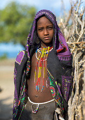 Portrait of an Erbore tribe girl, Omo valley, Murale, Ethiopia (Eric Lafforgue) Tags: africa africanculture anthropology arbore beautiful child children day decoration developingcountry eastafrica erbore ethiopia ethiopia0617381 ethiopian female hornofafrica jewel jewelry lookingatcamera murale necklaces omovalley onegirlonly oneperson outdoors portrait traditionalclothing tribal tribe vertical weito woman et