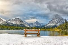 Cool Seat (Philip Kuntz) Tags: snow autumn praylake twomedicine glacier glaciernationalpark bench neverlaughswoman mtsinopah montana paintedteepeepeak explore