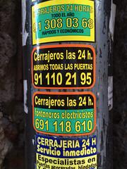 Cerrajeros las 24 h. (frankrolf) Tags: 24horas arial bauhaus cerrajeria cerrajeros helveticacondensed madrid stickers type:face=arial type:face=bauhaus type:face=helveticacondensed