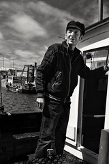 ... the boatman... (jane64pics) Tags: phone cameraphone htc snapseed blackandwhite bw boatman boat ireland howth janefriel janefriel2017