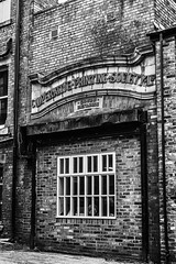 Defunct goods entrance (tootdood) Tags: canon70d blackandwhite monochrome manchester defunct goods entrance school street brick work cooperative printing services ltd