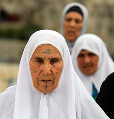 An Appendix to the Vision of Peace (ybiberman) Tags: israel jerusalem oldcity alquds muslimquarter ramadan woman tattoo veil hijab white candid streetphotography