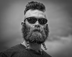 Bearded Mohawk Dude (Jim-Mooney) Tags: bw black white blackandwhite blackwhite mono monochrome monotone streetphotography portrait people fuji xt2 fujinon50140mm kansascity candid