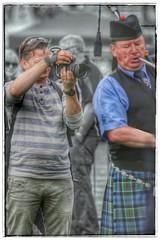 Shooting at Close Range (FotoFling Scotland) Tags: photographer camera shooter shoot piper bagpipe kilt highland games highlandgames male event helensburgh nmp