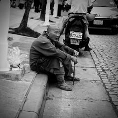 Curb Monk (Mondmann) Tags: monk curb street sitting streetphotography taipei taiwan republicofchina asia taiwanese asian travel religion blackandwhite bw pb mondmann fujifilmxt10 buddhist buddhistmonk buddhism
