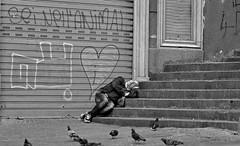 Symbolism. (Baz 120) Tags: candid candidstreet candidportrait city candidface candidphotography contrast street streetphoto streetcandid streetphotography streetphotograph streetportrait europe women monochrome monotone mono blackandwhite urban voightlandernokton50mm15asph voightlander leicam8 leica life primelens portrait people unposed italy italia girl grittystreetphotography faces decisivemoment strangers naples