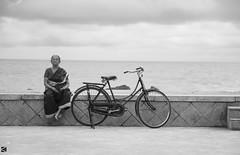 Beach Shore - Assures peace to any age. (Kanishka****) Tags: beach beachshore cycle monochrome old lady oldlady kanishkaphotography pondicherry frame holiday emotion canon70d canvas peace quiet