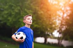 (Rebecca812) Tags: boy soccer sunlight lensflare soccerball sports childhood kids portrait canon rebecca812 people lowangle
