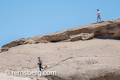 Tourists walking down large rock formations in the Namib desert, in Namibia, Africa. (Remsberg Photos) Tags: namibia africa namib desert tourist tourists walking rock boulder formation large sightseeing moving heat solitaire nam