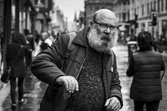 Caught Out In The Rain (Leanne Boulton) Tags: monochrome people portrait urban street candid portraiture streetphotography candidstreetphotography candidportrait streetportrait eyecontact candideyecontact streetlife man male face facial expression look emotion feeling movement motion eyes beard avoidance conflict wet rain weather raining tone texture detail depthoffield bokeh naturallight outdoor light shade shadow city scene human life living humanity society culture canon canon5d 5dmarkiii 70mm character ef2470mmf28liiusm black white blackwhite bw mono blackandwhite glasgow scotland uk