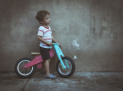 The biker. (Pablin79) Tags: girl boy people old outdoor motion child wood fun wall kid bike childhood one wheel argentina recreation wear misiones vini posadas