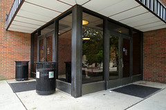 Independence Hall, Ohio State University — Columbus, Ohio (Pythaglio) Tags: independence hall building structure osu ohio state university columbus franklin county modern bland nondescript trash cans rubbish bins glass reflections brick sidewalk windows entrance doors paneling