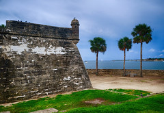Castillo de San Marcos in Florida (` Toshio ') Tags: toshio staugustine florida castillodesanmarcos spanish fort moat architecture history nationalpark palmtrees fujixe2 xe2 birds grass bay harbor sailboat boat