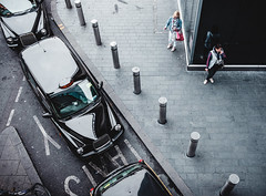 London taxi rank westfield shopping centre (garethottywill) Tags: path road london city taxi cabs black waiting smoking people ladys talking phone glass concrete colour blue pink shopping westfield fujifilm xt2 xf23mmf2 r wr