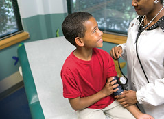 patsplace (patsplacecac) Tags: africanamerican boy child curious doctor exam female happy nurse pats patsplace place red relationship room white