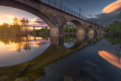 The Crossing (lonekheir) Tags: railway bricks water sunset clouds reflections trees