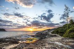 Sunrise in Ilhota Beach (rqserra) Tags: alvorecer amanhecer sol nuvens pedras praia reflexos natureza sunrise dawn sun clouds rocks beach reflexes nature itapema brazil rqserra