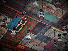 the rustic look (SM Tham) Tags: asia southeastasia indonesia bali island legian entrance portico ceiling windowshutters hurricanelamps oillamps lights colors patterns decorations design