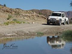 Namibia, Flooded Roads (jan-krux photography - thx for 3 Mio+ views) Tags: namibia africa afrika c24 remhoogte pass rain water wasser uberflutung jeep cherokee sport liberty 4x4 gravel unbefestigt dirtroad olympus em1 em1mkii safari travel reisen abenteuer adventure berge mountains fahren drive outdoor wild reflexions reflektion