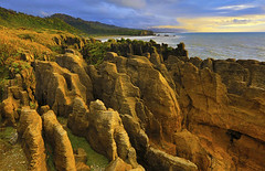 Pancake Rocks : Late evening . . . (Clement Tang **bbbusy**) Tags: travel nationalgeographic nature newzealand summer evening hdr sidelit seascape concordians closetonature bluesky southisland pancakerocks landscape limestonestacks scenicsnotjustlandscapes rockformation eveningclouds punakaiki ngc